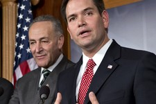 -                FILE - In this Jan. 28, 2013 file photo, Sen. Marco Rubio, R-Fla., right, accompanied by Sen. Charles Schumer, D-N.Y., gestures as he speaks during a bipartisan group of leading senator