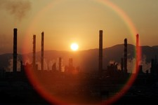 -                FILE - In this Tuesday, May 2, 2006, file photo, the sun sets over a oil refinery in Tarragona, Spain. In the 2000s, large investors in so-called clean technology wanted to finance comp