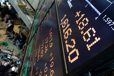 -                A board overlooking the floor of the New York Stock Exchange shows an intraday number above 1,600 for the S&P 500, Friday, May 3, 2013. A big gain in the job market is lifting the stock