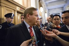 -                FILE – In this Feb. 14, 2013 file photo Sen. Bob Menendez, D-N.J., speaks to reporters as he enters the Senate chamber at the Capitol in Washington. An ethical cloud is following Menend