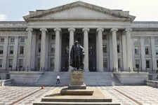 -                FILE - In this Aug. 8, 2011, file photo, a statue of former Treasury Secretary Albert Gallatin stands outside the Treasury Building in Washington. Absent a magic potion or explosive eco