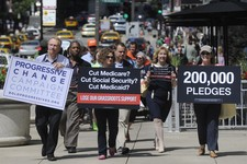 -                FILE - In this July 15, 2011, file photo, members of  Progressive Change Campaign Committee upset over potential cuts to Medicare, Medicaid and Social Security walk to President Barack