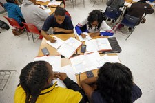 -                In this Feb. 15, 2013 photograph, Clarksdale High School students delve into the complexities of math, in Clarksdale, Miss. Community leaders hope improved education will help stanch a