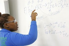 -                In this Feb. 15, 2013 photograph, Clarksdale High School student Shamia Hopper works on a chemical equation at the dry marker board in her Clarksdale, Miss., classroom. City  leaders ho