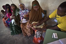 -                FILE - In this Wednesday, April 24, 2013 file photo, Somali mothers wait in line to have their babies examined before receiving a five-in-one vaccine against several potentially fatal c