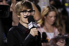 -                FILE - In this Friday, Jan. 14, 2011 file photo, Justin Beiber is seen interviewing on the red carpet at the 16th Annual Critics' Choice Movie Awards in Los Angeles. Dubai newspapers qu