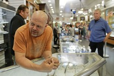 -                In this Wednesday, April 3, 2013, photo, Rick Harrison, owner of the Gold & Silver Pawn Shop waits as a camera crew prepares to shoot an episode of Pawn Stars at his shop in Las Vegas.