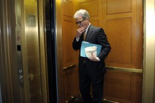 -                FILE - In this Dec. 31, 2012 file photo, Sen. Tom Coburn, R-Okla. gets into an elevator on Capitol Hill in Washington.  Gun control senators are discussing revising the defeated backgro