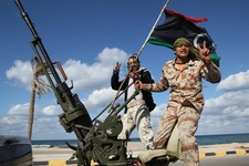 -                FILE - In this Tuesday Feb. 14, 2012 file photo, Libyan militia members from towns throughout the country's west parade through Tripoli, Libya.  A new law that excludes former officials