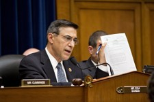 -                House Oversight Committee Chairman Rep. Darrell Issa, R-Calif., displays a letter of praise from President Obama to Gregory Hicks, former deputy chief of mission in Libya, number two in