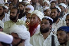 -                In this Thursday, May 2, 2013 photo, Supporters of a pro-Taliban religious group Jamiat-e-Ulema Islam (JUI-F), listen to their leader Maulana Shujaul Mulk, not pictured, during his an e