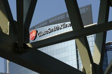-                FILE - In this April 20, 2009 file photo, a sign for British pharmaceuticals firm GlaxoSmithKline is seen on its offices, in London. On Thursday, May 9, 2013, the GAVI Alliance, a publi