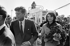 -                FILE - This Nov. 22, 1963 file photo shows President John F. Kennedy and his wife Jacqueline Kennedy upon their arrival at Dallas Airport, in Dallas, shortly before President Kennedy wa