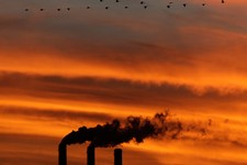 -                In this Sunday, Dec. 2, 2012 photo, a flock of Geese fly past the smokestacks at the Jeffrey Energy Center coal power plant as the suns sets near Emmett, Kan. Worldwide levels of the ch