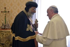 -                Pope Francis, right, welcomes Coptic Orthodox Church of Egypt Pope Tawadros II for their private audience in the pontiff's library, at the Vatican, Friday, May 10, 2013. The head of the