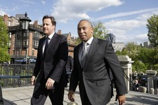 -                British Prime Minister David Cameron, left, walks with Massachusetts Gov. Deval Patrick into the Massachusetts Statehouse in Boston, Monday, May 13, 2013. Cameron met with Patrick to of