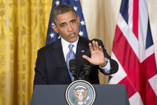 -                President Barack Obama gestures during a joint news conference with British Prime Minister David Cameron, Monday, May 13, 2013, in the East Room of the White House in Washington, where