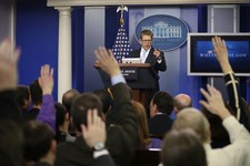 -                Reporters raise their hands as White House press secretary Jay Carney takes questions during his daily news briefing at the White House in Washington, Tuesday, May, 14, 2013. Carney tou