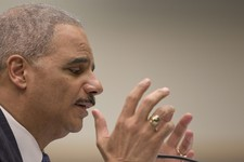 -                Attorney General Eric Holder gestures as he testifies on Capitol Hill in Washington, Wednesday, May 15, 2013, before the House Judiciary Committee oversight hearing on the Justice Depar