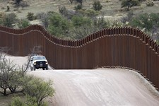 -                FILE - This April 22, 2010 file photo shows a Customs and Border Patrol agent patroling along the international border in Nogales, Ariz. A key House panel responsible for implementing s