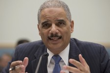 -                Attorney General Eric Holder gestures while testifying on Capitol Hill in Washington, Wednesday, May 15, 2013, before the House Judiciary Committee oversight hearing on the Justice Depa