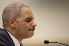 -                Attorney General Eric Holder pauses as he testifies on Capitol Hill in Washington, Wednesday, May 15, 2013, before the House Judiciary Committee oversight hearing on the Justice Departm