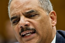 -                Attorney General Eric Holder reacts to aggressive questioning from Rep. Darrell Issa, R-Calif. as he testifies on Capitol Hill in Washington, Wednesday, May 15, 2013, as the House Judic