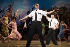 "-                This theater publicity image released by Boneau/Bryan-Brown shows Andrew Rannells, center, performing with an ensemble cast in ""The Book of Mormon"" at the Eugene O'Neill Theatre in New"