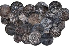 -                In this undated image made available on Thursday May 16, 2013 show coins from   Bohemia, Germany, Denmark and England discovered during an archaeological dig last year   Danish museum o