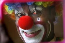 -                In this April 11, 2013 photo, Biju Nair, principal clown at Rambo Circus, looks at a mirror before a performance on the outskirts of Mumbai, India. Nair who literally ran away and joine