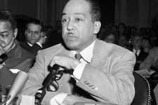 -                FILE - This March 26, 1953 file photo shows poet and author Langston Hughes speaking before the House Un-American Activities Committee (HUAC) in Washington, D.C. Hughes, Adrienne Rich,