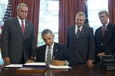 -                ADVANCE FOR USE SUNDAY, MAY 19, 2013 AND THEREAFTER - FILE - President Barack Obama signs the Honoring America's Veterans and Caring for Camp Lejeune Families Act of 2012 on Monday, Aug