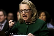 -                FILE – In this Jan.23, 2013, file photo U.S. Secretary of State Hillary Rodham pounds her fist as she testifies on Capitol Hill in Washington at the Senate Foreign Relations Committee h