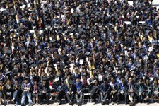 -                Graduating students listen to Apple co-founder Steve Wozniak deliver a commencement speech at the University of California at Berkeley on Saturday, May 18, 2013 in Berkeley, Calif. (AP