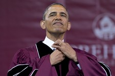-                President Barack Obama straightens his tie before he receives an honorary doctorate of laws degree during the Morehouse College 129th Commencement ceremony, Sunday, May 19, 2013, in Atl