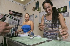 -                In this photo taken Tuesday, May 14, 2013, Rosy Solis, left, and Nicole Denis help fill medical marijuana prescriptions at the Venice Beach Care Center medical marijuana dispensary in V