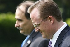 -                FILE - In this Aug. 11, 2009, file photo Senior White House Adviser David Axelrod, left, White House Press Secretary Robert Gibbs, right, leave with President Barack Obama, not shown, f