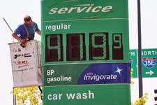 -                FILE - In this May 15, 2013 file photo, a service person works on sign at BP station at 35E and County Road E in Vadnais Heights, Minn. The average U.S. price of a gallon of gasoline ha