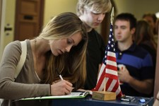-                FILE - In this Nov. 6, 2012 file photo, Madeline Nicole Kreyger, from Santa Barbara, Calif., casts her vote at a polling station on the campus of the University of Colorado in Boulder,