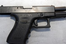 -                In this image released by the Pima County Sheriff's department, a Glock 9 mm pistol is seen in the aftermath of the Tucson shooting rampage that killed six people and wounded former U.S