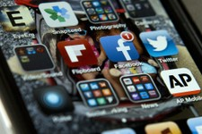 -                A view of an iPhone in Washington Tuesday, May 21, 2013, showing the Twitter and Facebook apps among others. A new poll finds that teens are sharing more about themselves on social medi