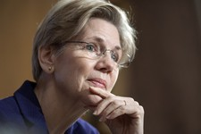 -                FILE - This March 7, 2013 file photo shows Sen. Elizabeth Warren, D-Mass., listening to a witness at Senate Banking Committee hearing on anti-money laundering on Capitol Hill in Washing