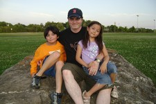 -                FILE - This June 2009 photo provided by Christopher Savoie shows him, center, with his son, Isaac, and daughter, Rebecca, at a park near their home in Franklin, Tenn.  The children were