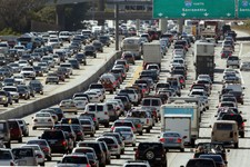 -                FILE - In this May 28, 2010 file photo, the rush hour commute starts in early afternoon and with greater intensity as traffic is jammed in both directions on Interstate 405 on the Wests