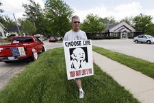 -                Coalition for Life of Iowa member Ron Digmann walks in front of the Planned Parenthood clinic, Tuesday, May 21, 2013, in Cedar Rapids, Iowa. When the Coalition applied for tax-exempt st