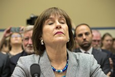 -                Lois Lerner, head of the IRS unit that decides whether to grant tax-exempt status to groups, listens on Capitol Hill in Washington, Wednesday, May 22, 2013, during a House Oversight and
