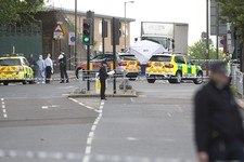 -                A tent is erected near the scene of an attack in Woolwich southeast  London Wednesday, May, 22, 2013. British officials said one person has died and at least two people have been wounde