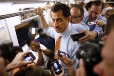 -                New York City mayoral hopeful Anthony Weiner speaks to reporters as he rides the subway to a radio appearance on the first day of his campaign, Thursday, May 23, 2013 in New York. Weine