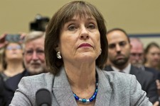 -                In this May 22, 2013, photo, Lois Lerner listens on Capitol Hill in Washington. A day after she refused to answer questions at a congressional hearing, Lerner has been replaced as direc