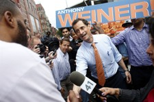 -                In his first campaign event, New York City mayoral hopeful Anthony Weiner greets commuters outside a Harlem subway station, Thursday, May 23, 2013 in New York. Weiner, who ran for mayor